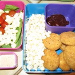 Raw corn and spinach salad, veggie nuggets, BBQ sauce