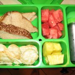 Sunflower Seed Butter and Jam Sandwich, Popped chips, Watermelon, pineapples